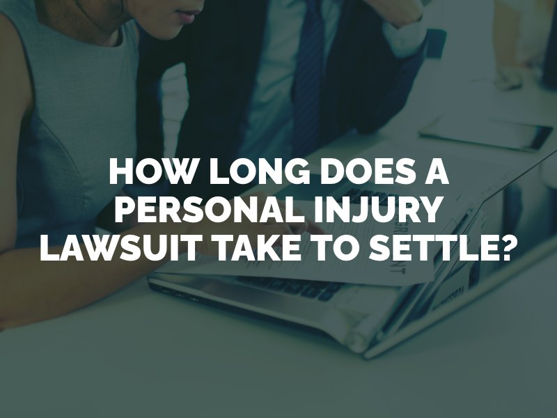 woman and her attorney looking at personal injury lawsuit